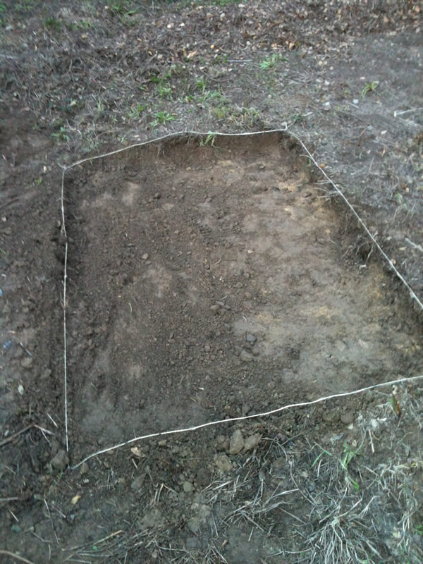 dirt plot ready for garden bed installation