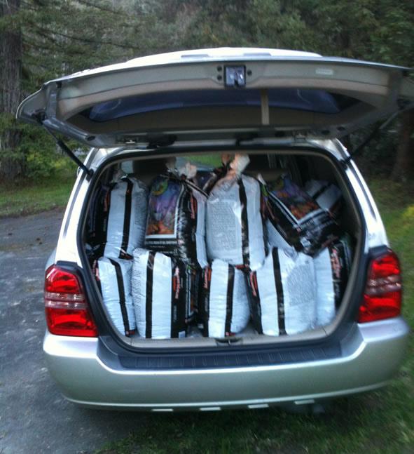 van trunk full of soil for garden